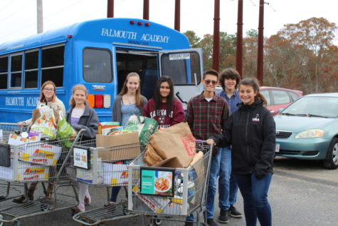 Students deliver the canned goods from the 2019 fall canned food drive. <I> Attribution: Mrs. Swanbeck </I>