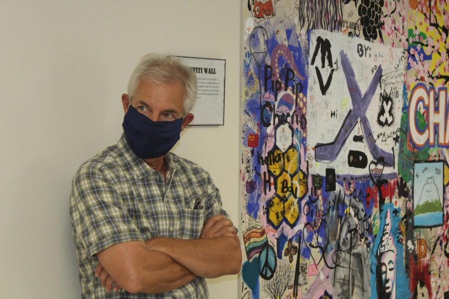 Mr. Swanbeck stuns in a navy mask outside the art rooms.