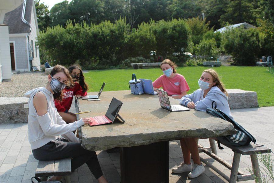 8th graders study in Hutker Yard. From left to right: Aubryn Dubois 25, Sophia Kahn 25, Maggie Ward 25, Sara Valle 25
