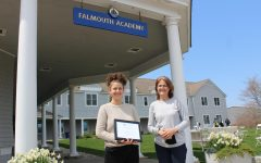 Guest writer Abby Neubert 22 poses with Mrs. Swanbeck after winning the Falmouth League of Women Voters essay contest